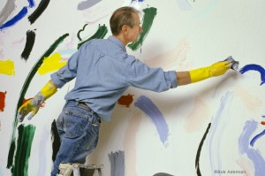Roy Lichtenstein laying in color on 10 x 15-foot painting Forest Scene with Temple (1986). © Bob Adelman