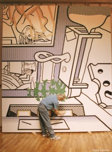 Roy Lichtenstein looking at his painting, Interior with Bonsai Tree (1991) in his Washington Street studio, ca. 1991. © Bob Adelman