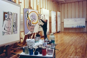 Roy Lichtenstein working on Seductive Girl (1996) in his Washington Street studio, ca. 1996. Also pictured: Coup de chapeau, Landscape with Bridge and Landscape with Philosopher (all 1996). © Bob Adelman