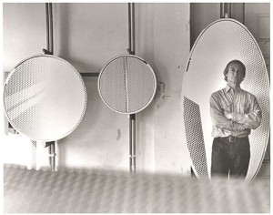 "Roy Lichtenstein standing in front of Mirror #1 (6' x 3') (1971) in his Southampton studio; also pictured: Mirror #8 (36"" diameter) (1971) and Mirror #12 (24"" diameter) (1970). © Renate Ponsold"