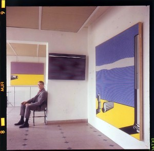 Roy Lichtenstein at Galerie Sonnabend, Paris, for the opening of his show in June 1965. Photograph: Shunk-Kender. © J. Paul Getty Trust. † The Getty Research Institute, Los Angeles (2014.R.20) Gift of The Roy Lichtenstein Foundation in memory of Harry Shunk and Janos Kender