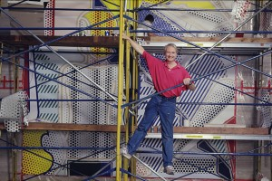 Roy Lichtenstein on scaffold at the CAA building in Beverly Hills, CA, painting Bauhaus Stairway Mural, 1989. © Alan Levenson
